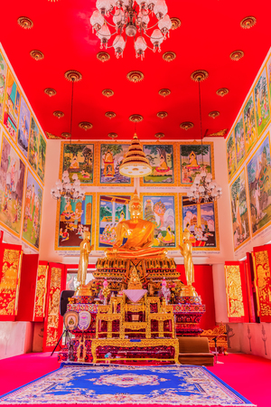 Phuket, Thailand - April 4, 2018: Buddha statue in Thai Buddist Church (vertical view), Naka temple, Phuket, Thailand