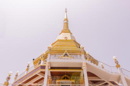 The beautiful pagoda at Naka temple with sky background, Phuket, Thailand