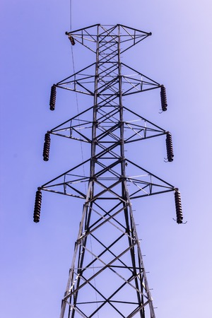 Un-finished construction of high voltage transmission tower in Thailand against the blue sky background