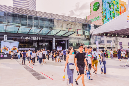 Bangkok, Thailand - July 8, 2017: Crowd of people is walking in front of Siam Center the world-class shopping center of Thailand. It is the well-known destination for tourists over the world.