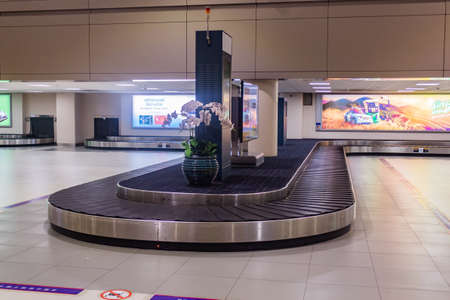 Bangkok, Thailand - Dec 14, 2019 : Empty conveyor belt for carrying the passenger luggages or baggage claim at at Don Mueang International Airport. Editorial