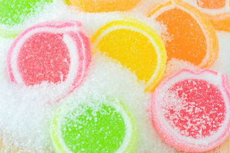 swirl backgrounds: Jelly sweet, flavor fruit, candy dessert colorful on sugar. Stock Photo