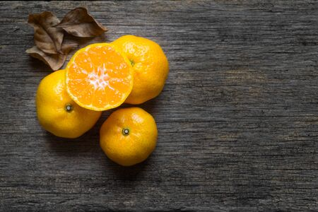 Orange fruit on a wooden background - Welcome autumn season concept. Imagens