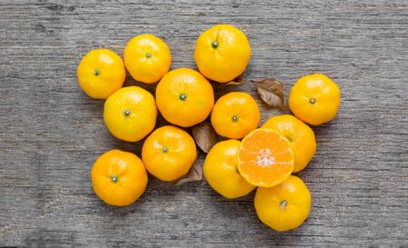 Oranges fruit on a wooden background - Welcome autumn season concept.