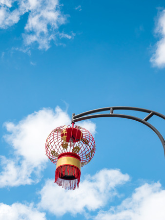 Chinese lanterns with blue sky and white clouds background.