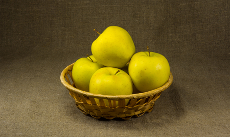 pectin: Several apples in a basket on a background of burlap Stock Photo