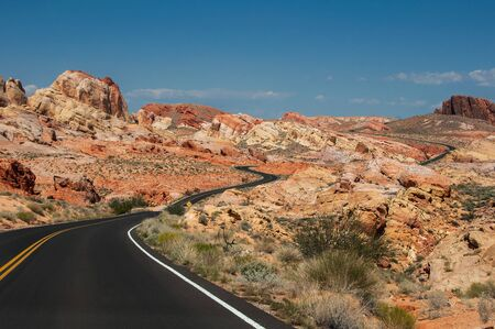 The road, going through the bright rocks of Valley of Fire State Park, located near Las Vegas, USA
