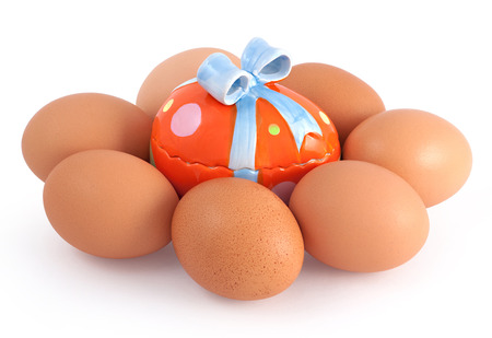 dissimilar: Colored toy egg surround by eggs Stock Photo