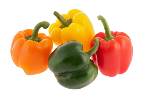 greeen: Orange, yellow, red and greeen bell peppers isolated on white