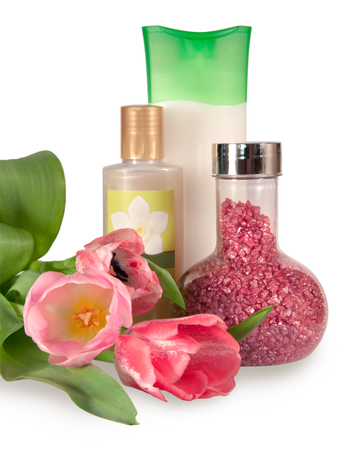 body wash: Bottles with bath salt,  shampoo and jasmine body wash with tree pink tulips isolated on white