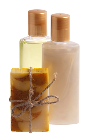 Handmade soap and bottles with shampoo and shower gel photo