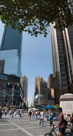 warner: Vertical panorama of Columbus Circle (Time  Warner Center and Trump Tower)from Central Park entrance  at Columbus Circle, New York, USA, September 2012