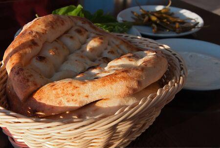 breadbasket: Turkish traditional bread in a breadbasket in a restaurant