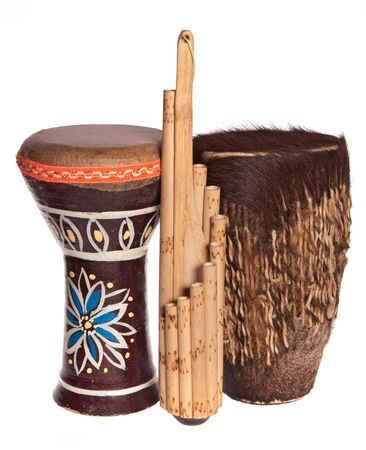 panpipe: Two african ethnic drums and a panpipes isolated on white