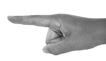forefinger: Monochrome human hand pointing by the forefinger isolated on white