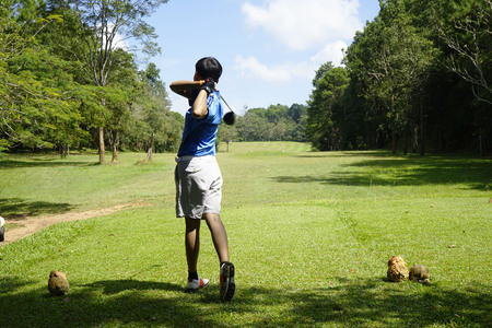 Golfer playing golf in beautiful golf course in the evening golf course with sunshine in thailand 写真素材
