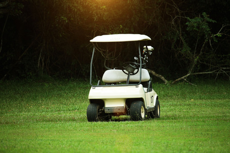 Golfcar in beautiful golf course in the evening golf course with sunshine in thailand