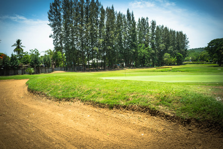 Background of evening golf course has sunlight shining down at golf course in Thailand