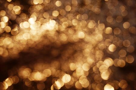 Gold abstract bokeh background. abstract grunge brown background with bokeh                                        Banco de Imagens