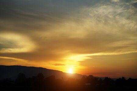 Beautiful clouds and golden sky. The beautifu sky with Sunset background. Standard-Bild