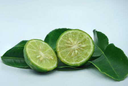 Fresh bergamot fruit with leaf and cut in half of bergamot on white background.