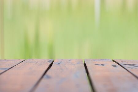 forest products: Empty wood table top on forest background. can montage or display your products Stock Photo