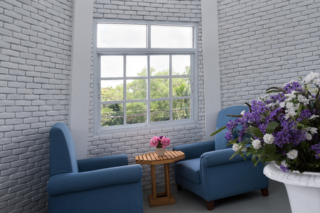 loft living: blue classic armchair in modern loft living room with white brick wall Editorial