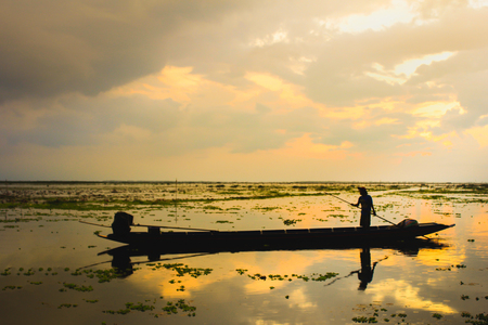pra: Silhouette fishing equipment, fishing net on sunrise background. Thai style fishing trap in Pak Pra Village, Phatthalung, Thailand, Asia.