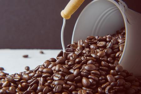 coffee beans with zinc bucket Stock Photo