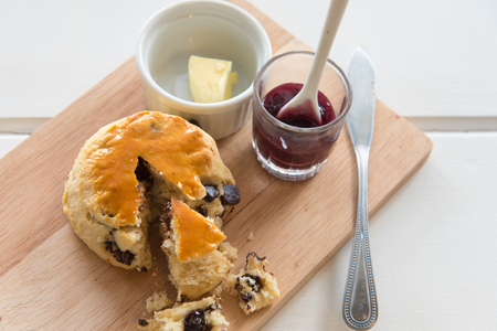 teacake: Freshly-baked chocolate scones - similar to American biscuits - cooling on a wire rack. Scones are a traditional British tea-cake
