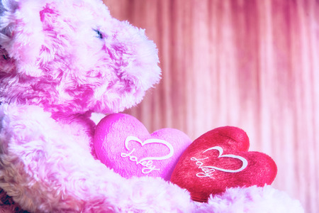 teddy Bear with Heart on wood background,concept valentine