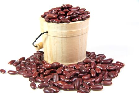 Red bean in casks isolated on white background