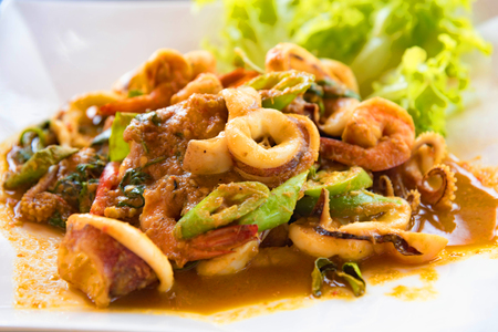 Stir fried prawn with chili paste on wooden table. Thai food