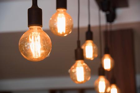 chandelier background: vintage lamp, bulb decorative in cafe