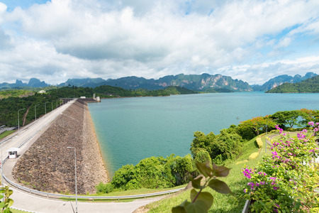 View at Ratchadapha Dam at Surat Thani. Mountains and water with sky and fog in the dam