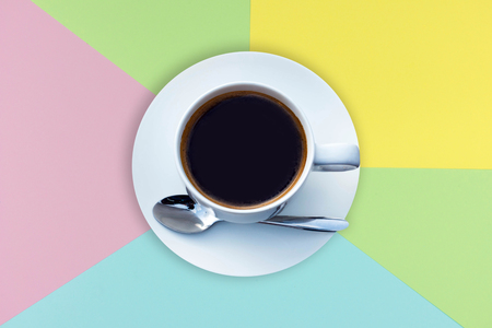 coffee cup on colorful paper background, empty space for add text or graphic design. food and drink concepts restaurant