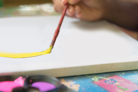 Creative ideas and learning. Education concept. Childs hands drawing. Colorful picture made by kids. Stock Photo