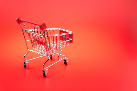 A Shopping Cart On red background, isolated shopping cart on the red