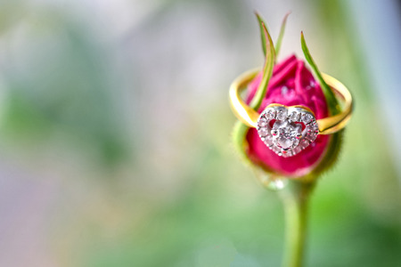 Heart shaped diamond ring with pink rose Stock Photo