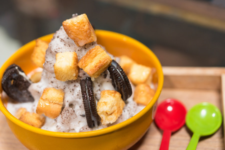 Korean Dessert - Chocolate bingsu or ice snow flake with fresh milk in korea style on wood table