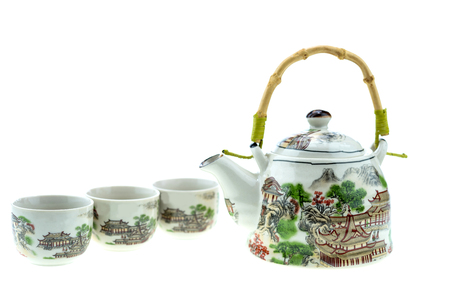 Teapot with cups on a white background. White teapot with Chinese style painting.