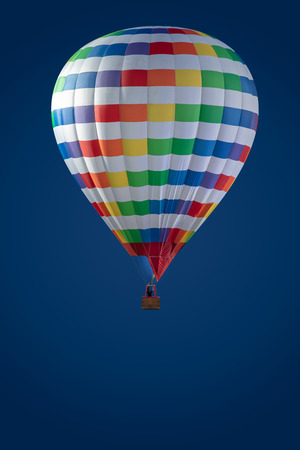 Hot air balloon in blue sky. Colourfull hot air balloon isolated on blue background. Colourfull Balloon festival in the sky. vertical