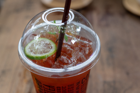 tea cocktail cola with lemon and ice. Take away tea cocktail cola with lemon in plasticglass.  Stock Photo
