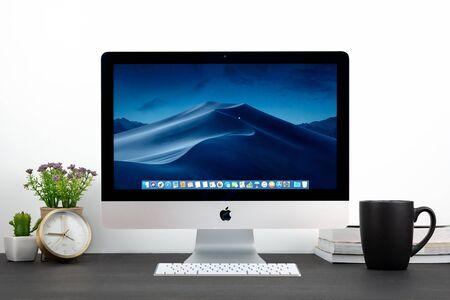 PHATTHALUNG, THAILAND - September 28, 2018: iMac computer, keyboard, magic mouse on wooden table, created by Apple Inc. Editorial
