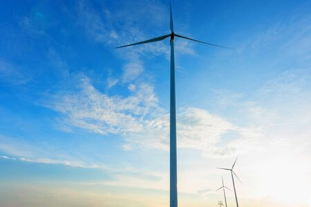 white turbine windmill against a beautiful blue sky. Foto de archivo