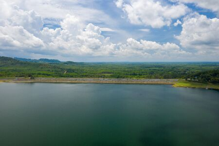 Dam Lake is located in Southern Thailand, lake serene with beautiful mountain background, Beautiful scenery of dam with mountain and lake view at Thailand, Asia. Banque d'images