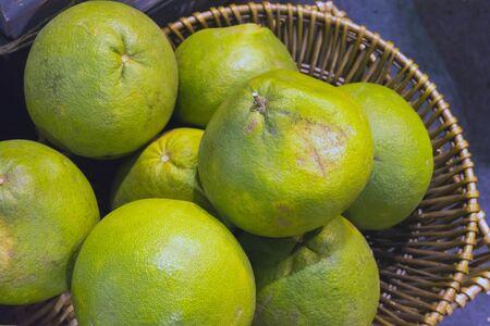 Green-yellow ripe pomelo, grapefruit, shaddock fruits from Thai farmer, Thailand market.