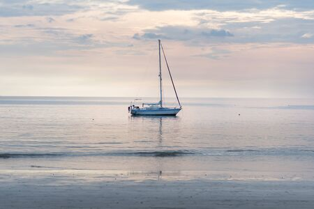 Sailboat in sea sky. Sailboat sitting in crystal clear waters off the coast of Phuket, Thailand
