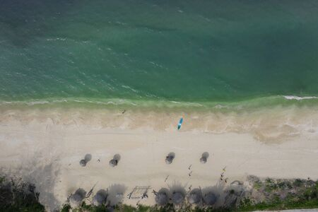 the blue sea with a coral reef and the beach, top view. Summer and travel vacation concept. 免版税图像