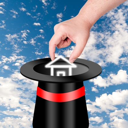 fulfill: hand pick up house from magic hat. Concept for magically get wishes fulfill.